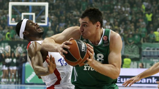 Panathinaikos' Jonas Maciulis, right, goes to score as Olympiakos' Brent Petway defends during their Euroleague basketball match of Top 16 at the Olympic Indoor Arena in Athens, Thursday, Feb. 20, 2014. (AP Photo/Thanassis Stavrakis)