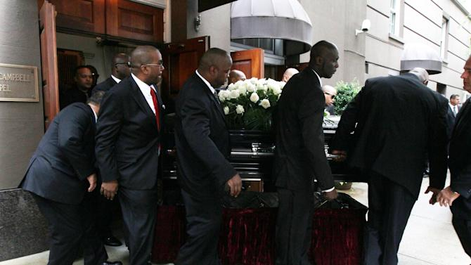 "A casket is carried out of the Frank E. Campbell Funeral Chapel following the service for hip-hop mogul Chris Lighty, Wednesday Sept. 5, 2012 in New York. Mourners in the packed chapel Wednesday included Sean ""Diddy"" Combs, Missy Elliott, Q-Tip, LL Cool J, Russell Simmons, 50 Cent and Grandmaster Flash. Lighty, 44, was found dead in his Bronx apartment last week with a gunshot wound to the head.  (AP Photo/Tina Fineberg)"