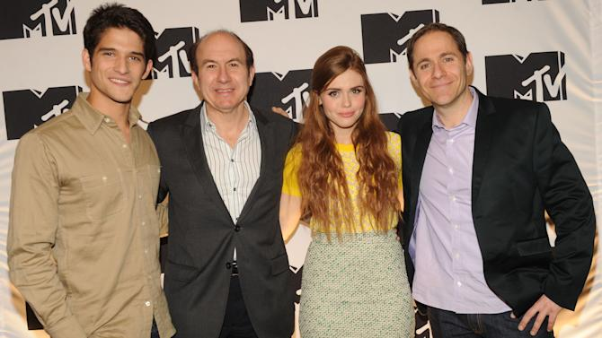 """IMAGE DISTRIBUTED FOR MTV - Tyler Posey from """"Teen Wolf"""", Philippe Dauman President and CEO Viacom, Holland Roden from """"Teen Wolf"""", Stephen Friedman President of MTV arriving at the 2013 MTV Upfront, on Thursday, April 25, 2013 at the Beacon Theater in New York. (Photo by Scott Gries/Invision/AP Images)"""
