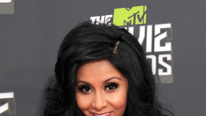 """Nicole """"Snooki"""" Polizzi arrives at the MTV Movie Awards in Sony Pictures Studio Lot in Culver City, Calif., on Sunday April 14, 2013. (Photo by Jordan Strauss/Invision/AP)"""