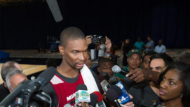Miami Heat forward Chris Bosh is interviewed during a break from a training camp session at the Atlantis Resort in Paradise Island, Bahamas, Tuesday, Oct. 1, 2013. The two-time defending NBA champions opened training camp Tuesday at the resort, with two practices scheduled for opening day