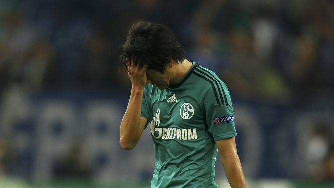 Schalke 04's Uchida reacts at the end their Champions League soccer match against Chelsea in Gelsenkirchen
