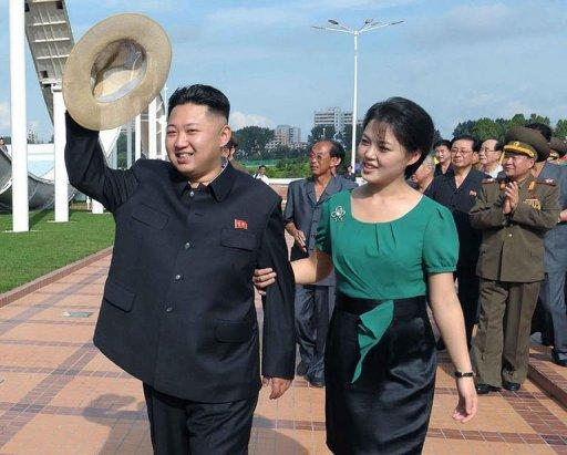 North Korean leader Kim Jong-Un (L), is shown with his wife Ri Sol-Ju in Pyongyang