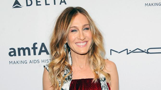 FILE - This Feb. 6, 2013 file photo shows actress Sarah Jessica Parker at amfAR's New York gala at Cipriani Wall Street in New York. Parker is donating a pair of Dolce Vita Pumps for a celebrity shoe auction benefitting LaGuardia High School of Music, Art and the Performing Arts. The special edition auction will take place starting Wednesday April 24, on https://ec.yimg.com/ec?url=http%3a%2f%2fwww.gottahaverockandroll.com.&t=1438667236&sig=fbXyJDtYHZU_Q8tORVHoBg--~C (Photo by Evan Agostini/Invision/AP, file)