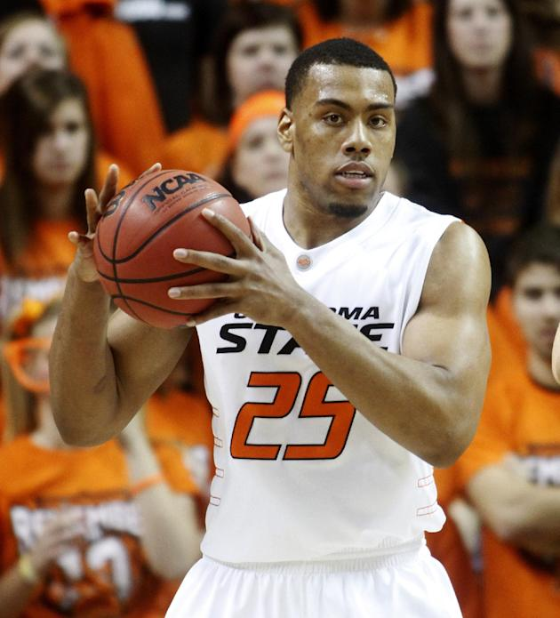 In this Jan. 26, 2011 file photo, Oklahoma State forward Darrell Williams plays in an NCAA college basketball game against Texas in Stillwater, Okla. Oklahoma's criminal appeals court has overturn
