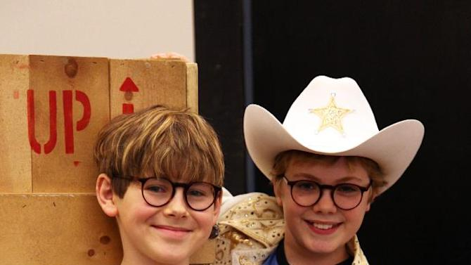 "In this Oct. 26, 2012, photo, Johnny Rabe, left, and Joe West pose during rehearsals for ""A Christmas Story, the Musical"" in New York. Both boys are taking turns playing the bespectacled, daydreaming hero Ralphie, who desperately wants an air rifle as a Christmas gift. (AP Photo/Mark Kennedy)"