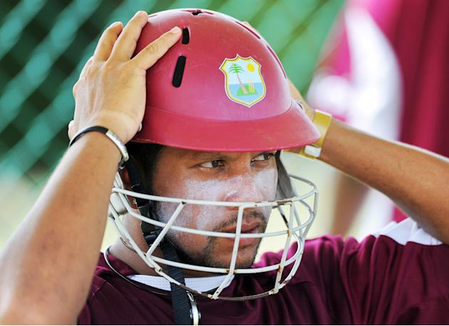 West Indies cricketer Ramnaresh Sarwan puts his helmet during a practice session at the Sir Vivian Richard Stadium in St John's on June 10, 2011. West Indies will face India for the 3rd One Day In