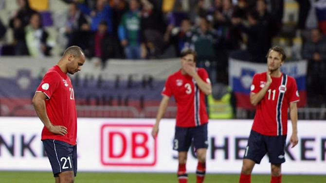 Norway's Daniel Braaten, left, Johan Lodre Bjordal and Magnus Wolff Eikrem, right, look dejected after receiving third goal during the 2014 World Cup group E qualifier soccer match between Slovenia and Norway in Maribor, Slovenia, Friday, Oct 11, 2013