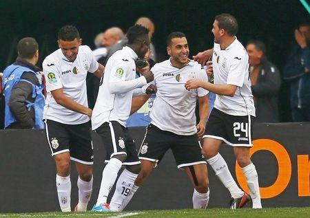 Ziaya of Entente Setif celebrates with after scoring a goal during their African Super Cup soccer match against Al-Ahly in Blida