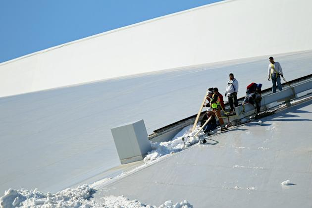 Workers Clear Ice From The Top Of Cowboy Stadium Ahead Of Super Bowl XLV