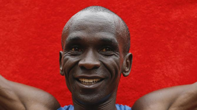 Eliud Kipchoge of Kenya celebrates afterwinning the Men's race in the 35th London Marathon, Sunday, April 26, 2015. (AP Photo/Kirsty Wigglesworth)