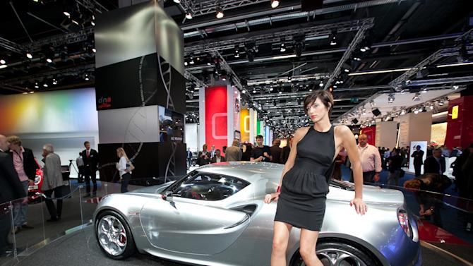 A hostess leans on the Alfa Romeo Concept Car 4C during the press day of the Frankfurt Auto Show IAA in Frankfurt, Germany, Tuesday, Sept. 13, 2011. The fair opens its doors to the public Sept. 15 to Sept. 25, 2011. (Yahoo! Autos Photo/Roberto Kerian)