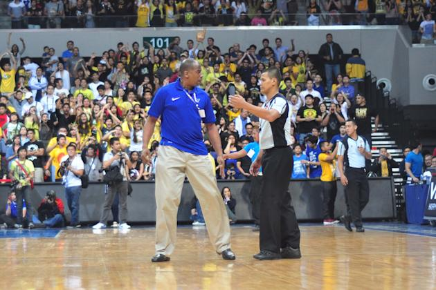 UST is questioning why Ateneo caoch Norman Black wasn't called for a technical foul after storming the court, and why Karim Abdul was called for goal-tending in the last five seconds. (NPPA)