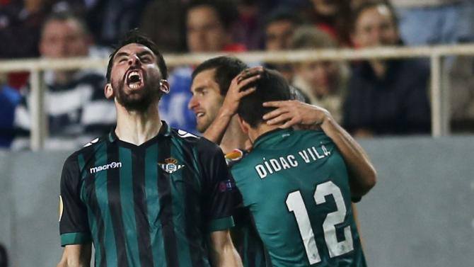 Real Betis' players celebrate their goal against Sevilla during their Europa League soccer match in Seville