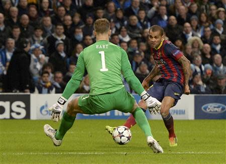 Barcelona's Dani Alves scores past Manchester City's goalkeeper Joe Hart during their Champions League round of 16 first leg soccer match at the Etihad Stadium in Manchester