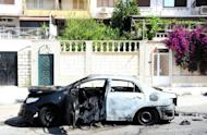 A Syrian Arab News Agency photo from on June 11, 2012 shows a burnt car the government says was blown up by an armed group in the neighbourhood of Barza in Damascus. More than 14,100 people have been killed since an anti-regime revolt broke out in March last year, including 9,862 civilians, 3,470 soldiers and 783 army defectors, according to the watchdog