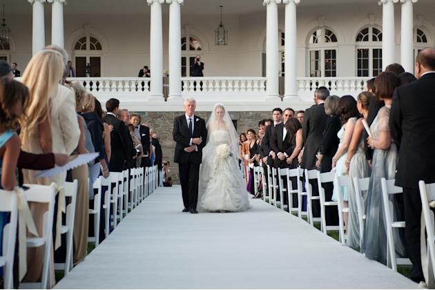 Former U.S. President Bill Clinton walks daughter Chelsea down the aisle