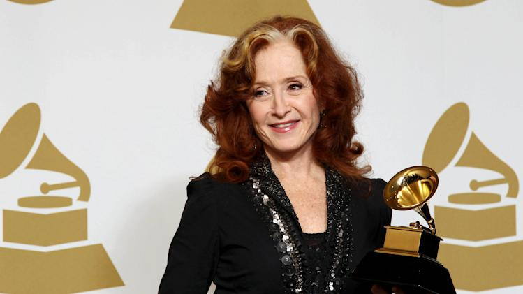 Bonnie Raitt poses backstage with the award for best americana album for