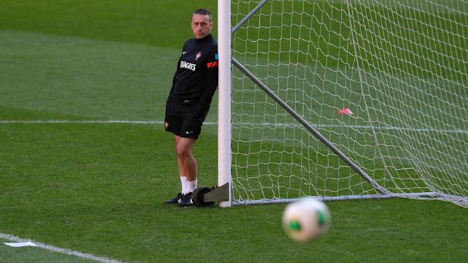 Portugal's coach Paulo Bento watches the players warm up during a training session Sunday, Nov. 17 2013, at the Luz stadium in Lisbon. Portugal will play Sweden Tuesday in a World Cup qualifying playoff second-leg soccer match