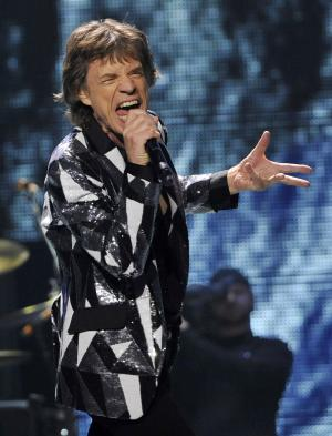 "Mick Jagger of the Rolling Stones performs on the kick-off of the band's ""50 and Counting"" tour at the Staples Center on Friday, May 3, 2013 in Los Angeles. (Photo by Chris Pizzello/Invision/AP)"