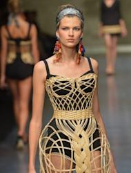 Models walk the runway at the Dolce & Gabbana show on September 23 during Milan fashion week. Worn under netting or over black underwear, the corsets put a modern spin on an antique femininity, recasting the Sicilian noblewoman for the 21st century