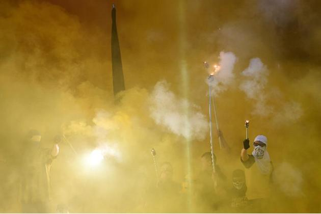 Dortmund fans burn flares during the German Cup DFB Pokal final football match between BVB Borussia Dortmund and VfL Wolfsburg at the Olympic Stadium in Berlin on May 30, 2015