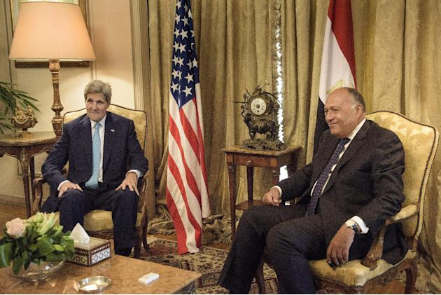 U.S. Secretary of State John Kerry, left, speaks with Egypt's Foreign Minister Sameh Shoukry, before a meeting at the Ministry of Foreign Affairs in Cairo, Egypt, Sunday, Aug. 2, 2015. Kerry met S