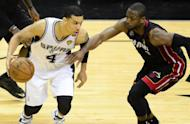 Danny Green of the San Antonio Spurs dribbles past Dwyane Wade of the Miami Heat on June 16, 2013. The Spurs are making a habit of winning bounce back games in the 2013 National Basketball Association playoffs