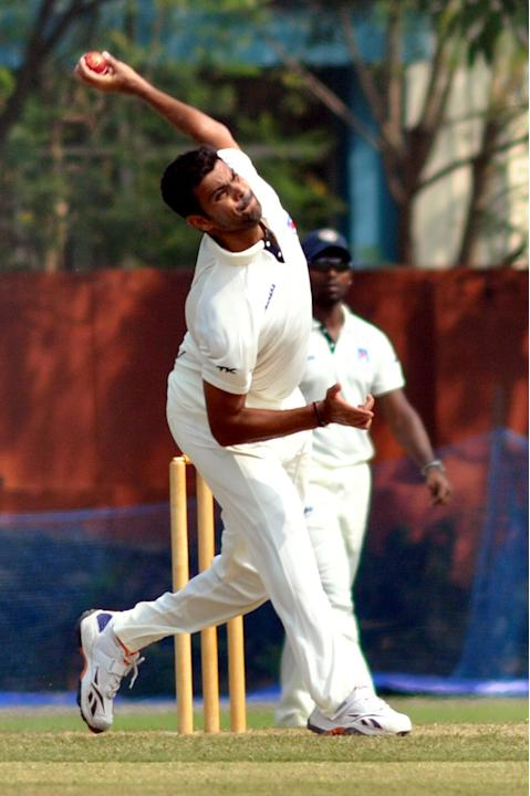 R P Singh in action during a practice match between Uttar Pradesh Cricket Association XI and West Indies at the Jadavpur University Ground in Kolkata on Oct.31, 2013. (Photo: IANS)