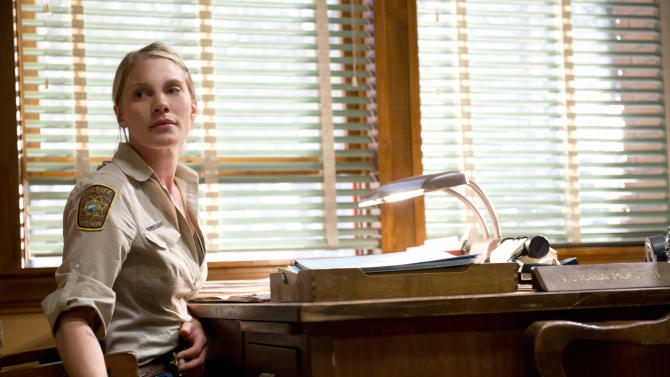 """This undated image released by A&E shows actress Katee Sackhoff portraying Victoria """"Vic"""" Moretti in a scene from A&E's new original drama series, """"Longmire.""""  Sackhoff, 32, has had success playing women who aren't shrinking violets. She starred as Kara """"Starbuck"""" Thrace on """"Battlestar Galactica,"""" which made her a fan boy sex symbol. Now she's holding her own as Deputy Sheriff Victoria """"Vic"""" Moretti on """"Longmire,"""" based on the best-selling novels by Craig Johnson. (AP Photo/A&E, Ursula Coyote)"""