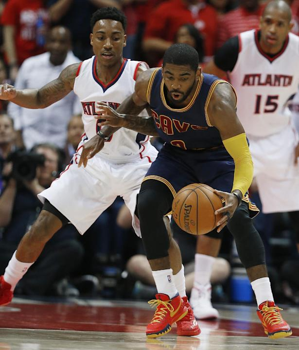 Cleveland Cavaliers guard Kyrie Irving (2) moves the ball as Atlanta Hawks guard Jeff Teague (0) looks on during the first half in Game 1 of the Eastern Conference finals of the NBA basketball playoff
