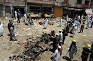 Pakistani security officials inspect the site of a bomb explosion in the main bazaar of Landi Kotal in Khyber tribal district. A car bomb ripped through a market area in a northwest Pakistan tribal town near the Afghan border, killing 25 people including three children