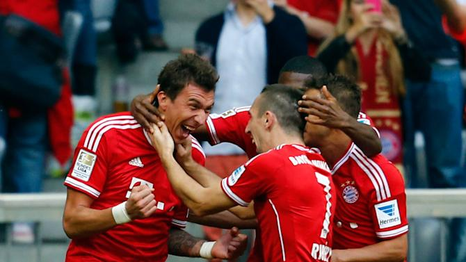 Mandzukic of FC Bayern Munich celebrate during their German first division Bundesliga soccer match against Hertha Berlin in Munich