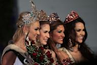 (L-R) Miss Earth 2012 from Czech Republic, Tereza Fajksová. Miss Air from Philippines, Stephany Stefanowitz. Miss Water from Venezuela, Osmariel Villalobos. Miss Fire from Brazil, Camila Brant. (George Calvelo/NPPA Images)
