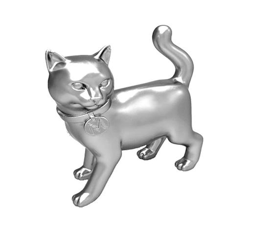 The cat token has replaced the iron in the famous Monopoly game (Hasbro)