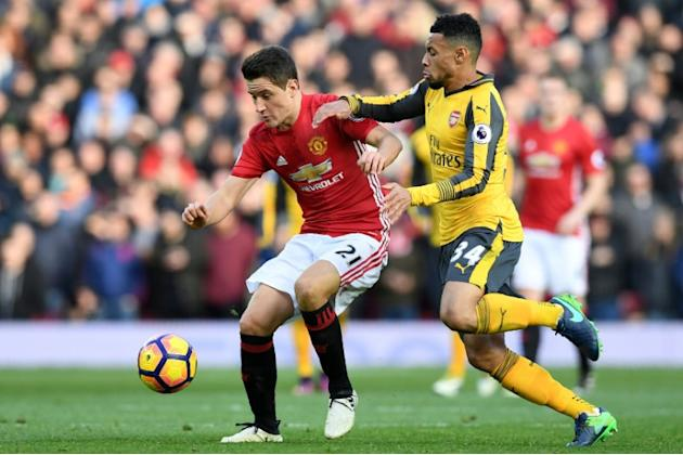 Manchester United's Spanish midfielder Ander Herrera (L) vies with Arsenal's French midfielder Francis Coquelin during the English Premier League football match between Manchester United and A