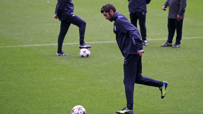 Porto's coach Fonseca kicks a ball during a training session at Dragon stadium in Porto