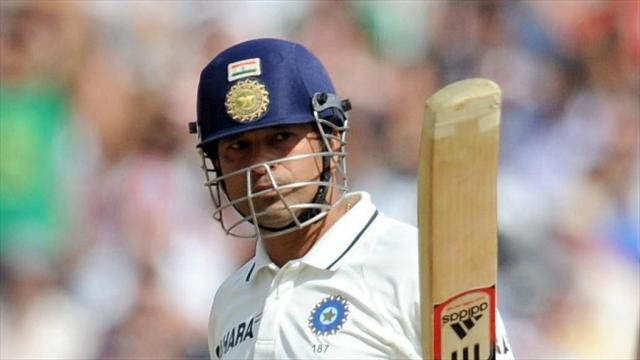Cricket - Tendulkar walks out to guard of honour in farewell Test