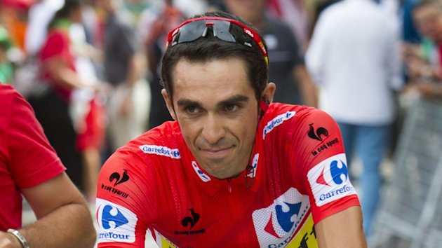 Alberto Contador shrugged off his Tour de France disappointment by storming to victory at the Vuelta a Espana