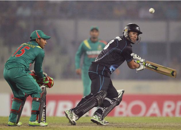 New Zealand's Taylor plays a shot as Bangladesh's Rahim watches during their second one-day international cricket match in Dhaka