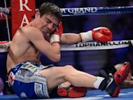 Mexican Jorge Arce winces in pain after suffering a blow to the ear from Puerto Rican Jesus Rojas during their featherweight fight on June 9. The clash was declared a no-contest when Rojas caught Arce first with a low-blow and then with a swinging punch to the ear in the second round