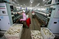 Chinese women are seen working at a cotton thread factory in Huaibei, in eastern China's Anhui province. China's industrial output grew at a slower-than-expected 9.6 percent year-on-year in May, a faster clip than the previous month but still near three-year-lows, according to the latest government data