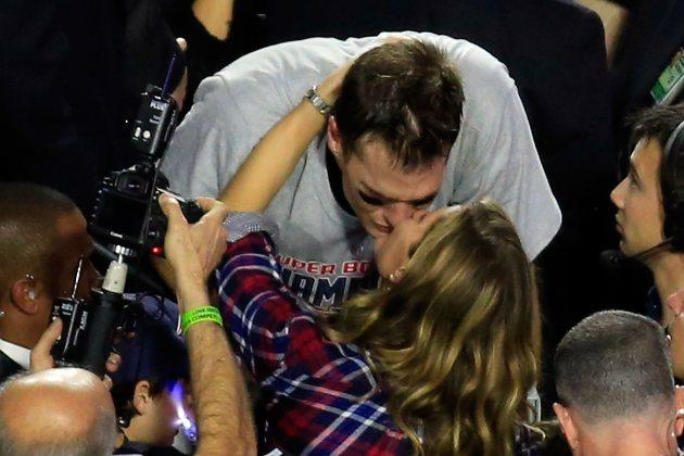 Tom Brady of the New England Patriots kisses his wife Gisele Bundchen after defeating the Seattle Seahawks 28-24 during Super Bowl XLIX at University of Phoenix Stadium on February 1, 2015 in Glendale