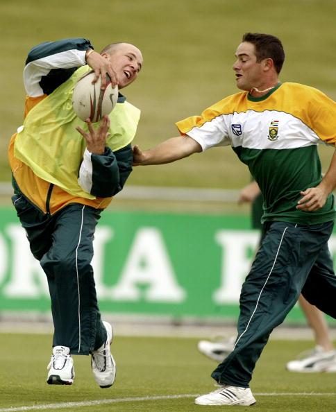 14 Jan 2002:  Boeta Dippenaar avoids Mark Boucher in a game of touch rugby, during South Africa Training at Bellerive Oval, Hobart, Australia. DIGITAL IMAGE. Mandatory Credit: Hamish Blair/Getty Image