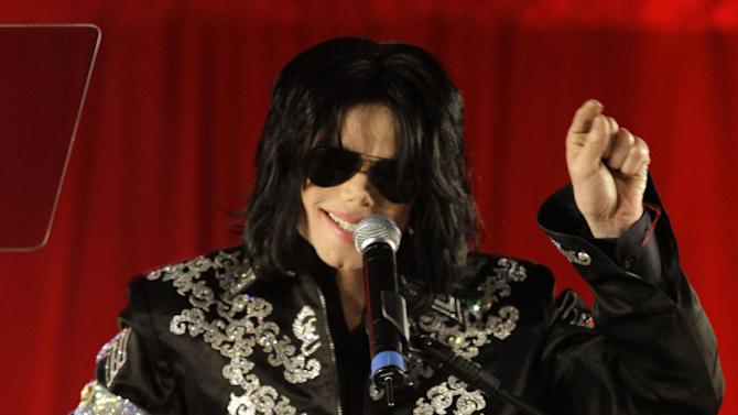 "FILE - In this March 5, 2009 file photo, Michael Jackson announces several concerts at the London O2 Arena in July, at a press conference at the London O2 Arena. Stacy Walker, a choreographer who worked with Jackson in his ill-fated ""This Is It"" shows, told a civil jury in a Los Angeles courtroom on Monday May 13, 2013, that she did not see any signs that the singer was ill or might die in his final days and weeks. Walker is AEG's first defense witness in a civil case filed by Jackson's mother, Katherine Jackson, who claims the concert giant failed to properly investigate or supervise the doctor convicted in 2011 of causing the singer's death.   (AP Photo/Joel Ryan, file)"