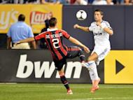 Cristiano Ronaldo (R) of Real Madrid fights for the ball with Mattia De Sciglio of AC Milan during their friendly match, on August 8, at Yankee Stadium in New York. Real Madrid won 5-1
