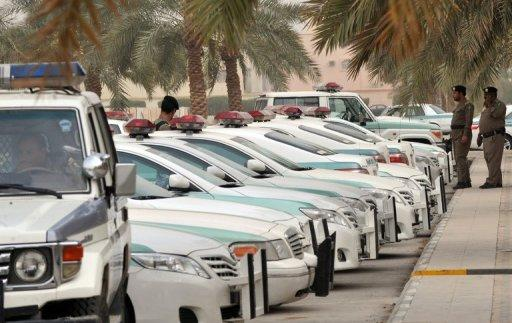 Saudi police cars are parked and policemen stand guard in front of a mosque in central Riyadh on March 11, 2011. Saudi Arabia's police force said Saturday it is investigating a series of attacks against members of the force in the Shiite-majority district of Qatif