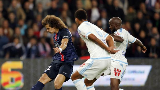 Paris St Germain's Moreira challenges Olympique Marseille's Pires during their French Ligue 1 soccer match at the Parc des Princes stadium in Paris