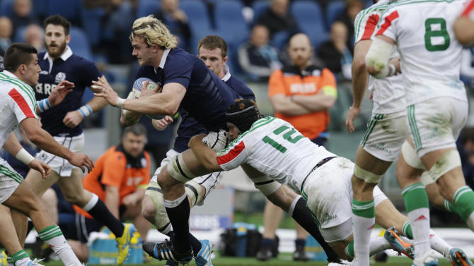 Scotland's Richie Gray, left, is tackled by Italy's Gonzalo Garcia during a Six Nations rugby union international match between Italy and Scotland, Saturday, Feb. 22, 2014. (AP Photo/Andrew Medichini)