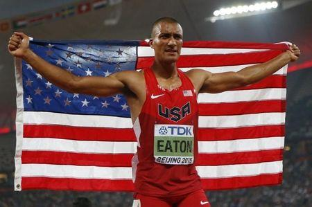 Eaton from the U.S. reacts after setting a new world record of 9045 points in the men's decathlon during the 15th IAAF World Championships at the National Stadium in Beijing